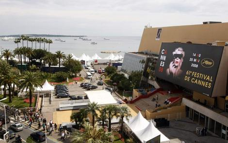 A general view of the Festival Palace covered by official poster for the 61st Cannes Film Festival